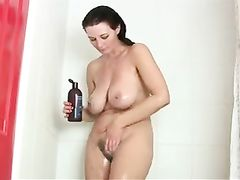 Busty mature woman with hairy pussy naked in the shower