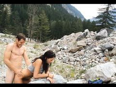 Exhibitionist couple making sex doggystyle outdoor in the mountains